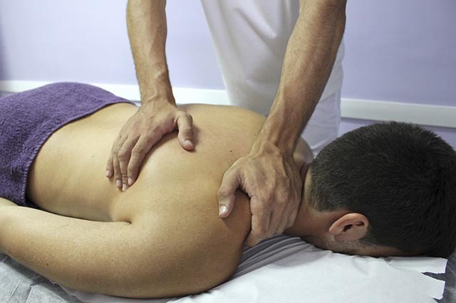 deep tissue sports massage on back